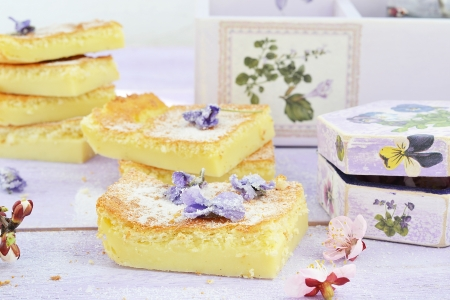 Custard Cake and violet flowers  photo