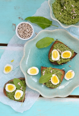 speciality: canape with dock pesto and qwail  eggs Stock Photo
