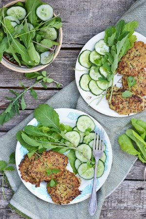 fritter: quinoa and zucchini  pancakes with green salad  Stock Photo