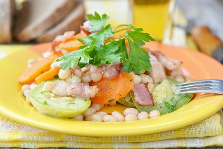 vegetables salad with bacon and lager beer photo