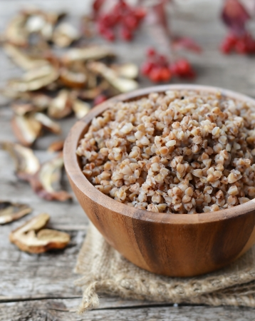 kasha: buckwheat groats in a wooden bowl Stock Photo