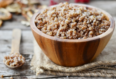 buckwheat groats in a wooden bowl photo