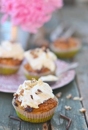 carrot cupcakes on rustic background photo