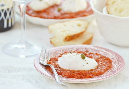 poach:  poached egg with tomato sause  in to the plate Stock Photo