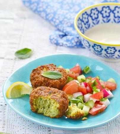 falafel: falafel with tehina  sauce and vegetable salad Stock Photo