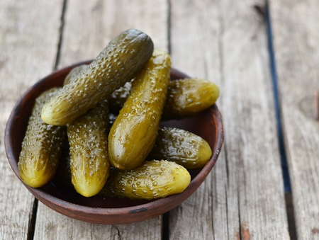 pickled cucumber, russian traditional appetizer in ceramik dish photo