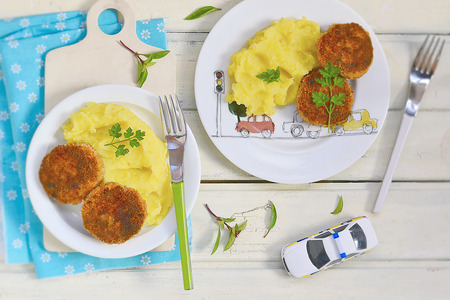 fish cutlets with  mashed potatoes. lunch for kids photo