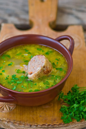 jewish cuisine: chicken soup with the stuffed chicken neck. Jewish cuisine Stock Photo