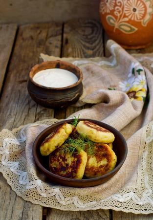 potato patties with fried  bacon  and onions.Ukrainian cuisine. photo