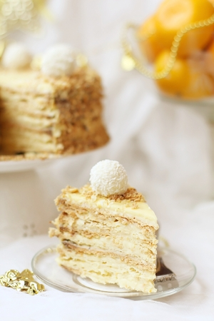 custard slices: New Years pie  a napoleon  on a festive light background