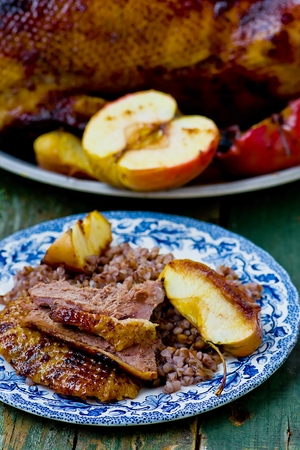 christmas goose: the Christmas baked goose with apples. vintage style. Stock Photo
