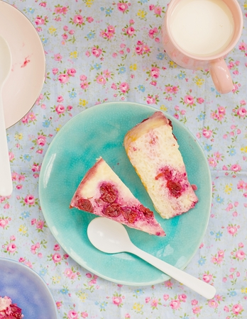 cottage cheese pudding with cherry, a milk cup for a breakfast on a white table photo