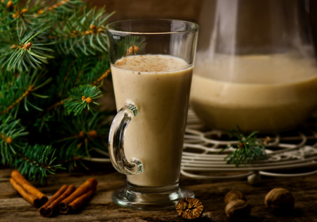 egg nog on a rustic background with a New Years decor in vintage style. selective focus. Stock Photo