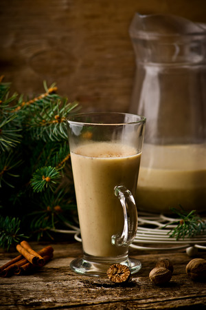egg nog: egg nog on a rustic background with a New Years decor in vintage style. selective focus. Stock Photo