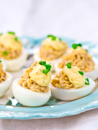 stuffed fish: delicious stuffed eggs on blue plate. selective focus Stock Photo