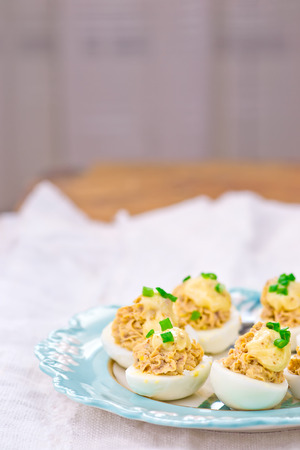 egg white: delicious stuffed eggs on blue plate. selective focus Stock Photo