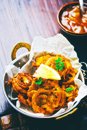 onion bhaji: onions  bhaji with mango chutney. Indian cuisine