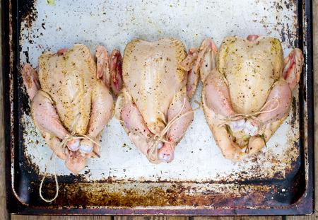crude: fresh, crude farmer chicken on a wooden background