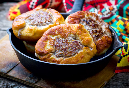 pasty: belyash ,yeast dough round pasty with meat filling . style rustic. Stock Photo