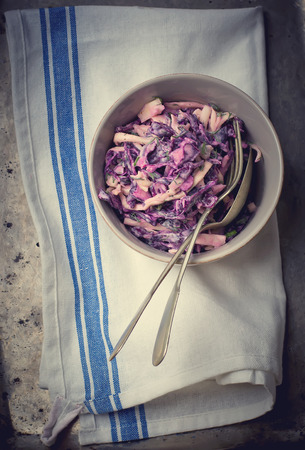 american cuisine: salad Cole slaw  from a red cabbage. American cuisine. style vintage. selective focus. the image is tinted Stock Photo