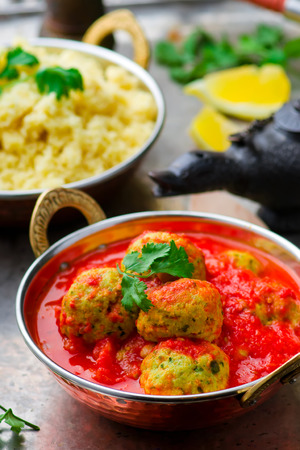moroccan cuisine: fish croquette in tomato sauce in a copper bowl on a metal background. Moroccan cuisine. style vintage. selective focus.