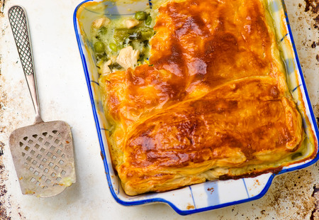 Puff pastry pie with chicken and vegetables. top view. selective focus. style vintage photo