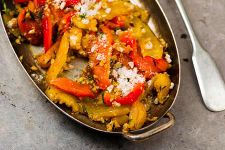 red braised: stewed sweet pepper with parmesan in Italian. style vintage. selective focus.