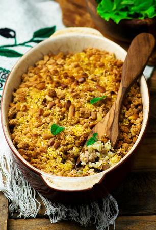 forcemeat: Crumble with forcemeat and sunflower seeds. healthy food. selective focus