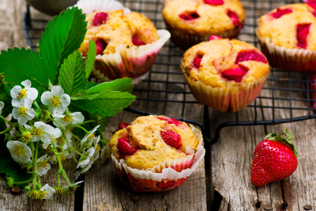 rustic food: muffins with bran and strawberry. healthy food. style rustic. selective focus.