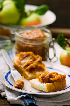 breackfast: caramel apple butter on bread slices. style vintage. selective focus