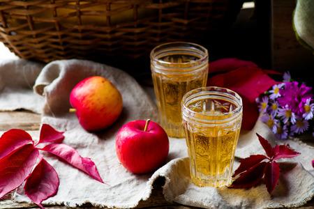 cider: apple cider in vintage glass glasses. style rustic. selective focus