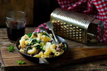 chard: pasta with swiss chard ,sausages and cheese style vintage. selective focus Stock Photo