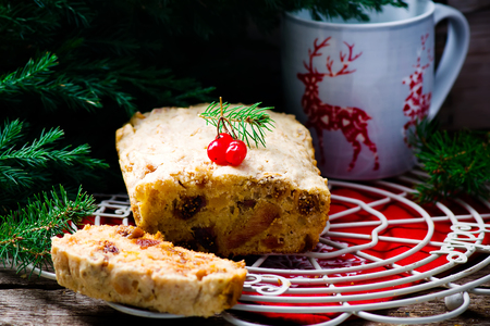 homemade cake: Christmas cake on a Christmas rustic background. selective focus. the image is tinted