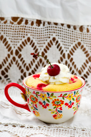 quick snack: mug cake prepared in microwave. horizontal permission. selective focus Stock Photo