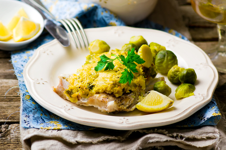 brussel: The baked fish fillet with brussel cabbage. Stock Photo