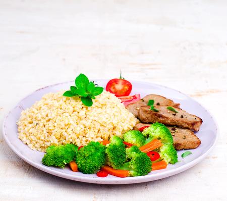 bulgur: Steak with bulgur and vegetables. Stock Photo