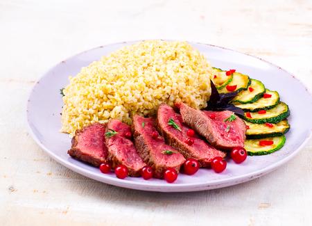 bulgur: Steak with bulgur and vegetables
