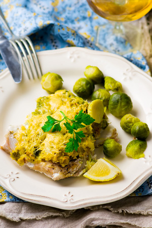 brussel: The baked fish fillet with brussel cabbage. selective focus