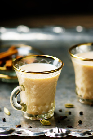 assam tea: Indian masala tea in glass cups on a metal background. style vintage. selective focus