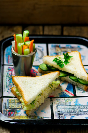 english cucumber: sandwiches with egg salad  and cucumber . style vintage. selective focus