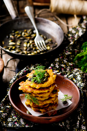 fritters: potato and pumpkin  fritters with dill. style rustic.selective focus