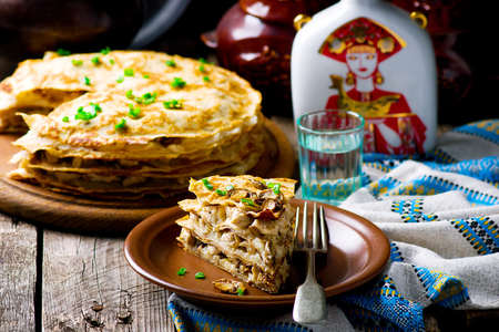 pancake week: blinis pie with mushrooms and chicken. selective focus Stock Photo
