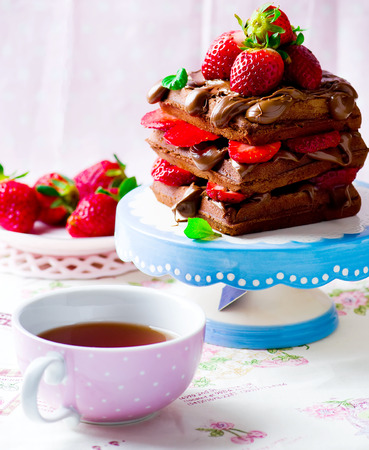 nutella: waffle with nutella and strawberry .selective focus Stock Photo