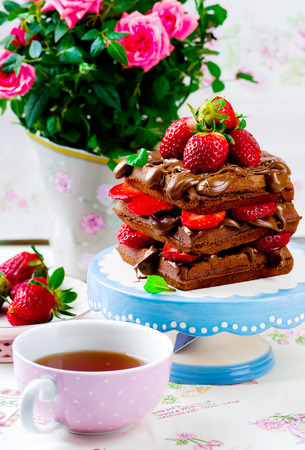food dish: waffle with nutella and strawberry .selective focus Stock Photo