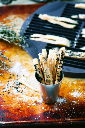 gressins: breadsticks with herbs and seeds. selective focus