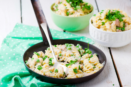 pea: pasta with green peas, tuna and creamy sauce. style vintage. selective focus.