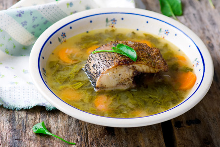 sour grass: Soup with a sorrel fish. Selective focus. Style rustic
