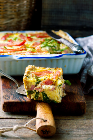 green onions: quiche with green onions and ham. style rustic.  selective focus