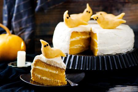 Pumpkin cake for Halloween. Selective focus. Dark photo Stock Photo