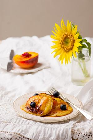caramelized: Caramelized Peach Pancakes .vintage style .selective focus